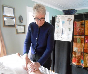 Alice Kenly demonstrating a healing Swedish Massage technique.
